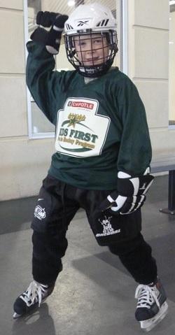 Child in full hockey equipment